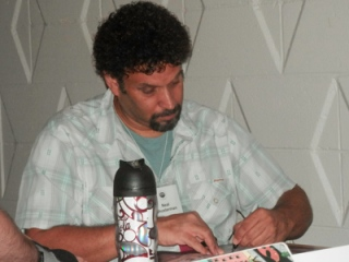 Neal Shusterman signs my book