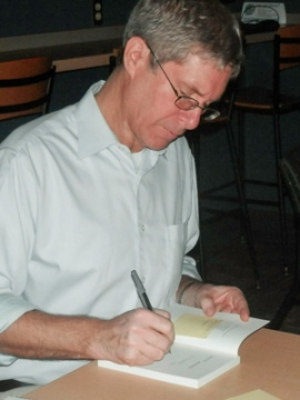 Kevin Henkes signs his book